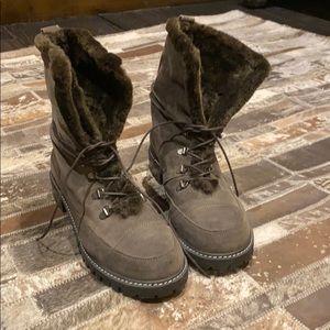 Brown Stuart Weitzman fur lined boots.
